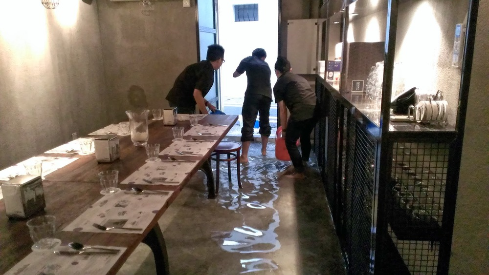 The Lolla team cleaning the basement, which had been flooded by rain