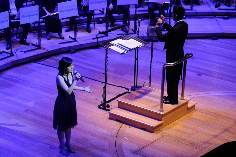 """Ethel: I had the great honour and privilege of performing in the Esplanade Concert Hall with the Singapore Wind Symphony in a tribute concert to Dick Lee's music in July 2013. This is a shot of me singing """"When All The Tears Have Dried"""" from Dick Lee's musical, Sing To The Dawn. At the end of the concert I even had the chance to sing Fried Rice Paradise with him and with the other guest singers - it was great fun. The man is a legend."""