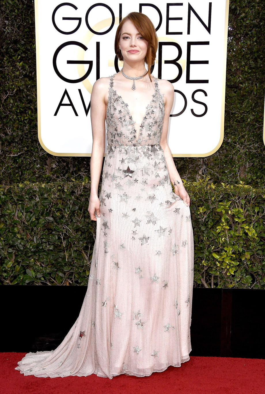Emma Stone in Valentino (Photo Credit: Frazer Harrison / Getty)