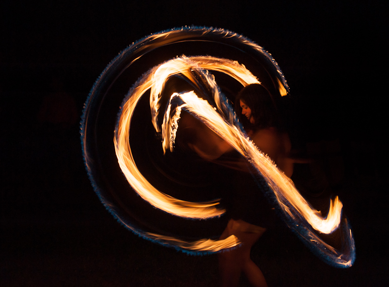 woman spinning fire with poi.jpg