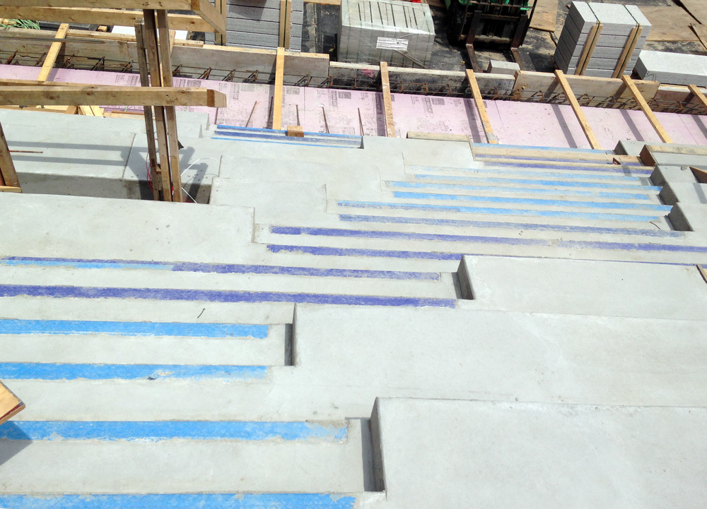 Stairs with tape protecting the steel nosing