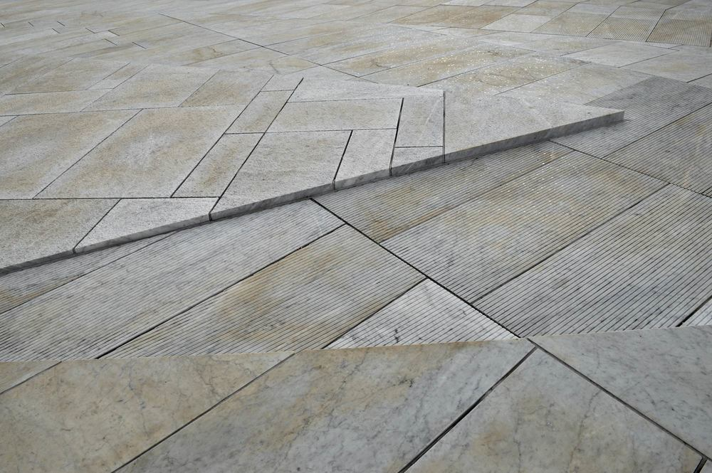 A variety of marble shapes and textures make up the 'carpet' that covers the Opera house