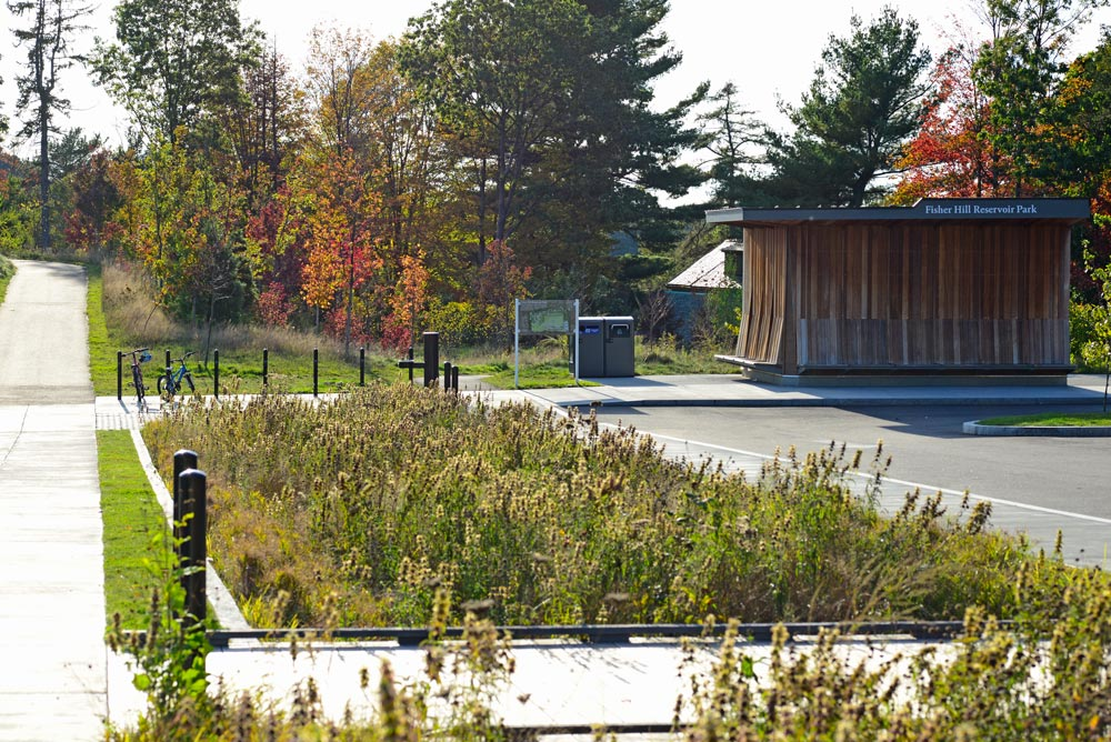 Looking across a bioretention basin at the Touloukian Touloukian designed comfort station.