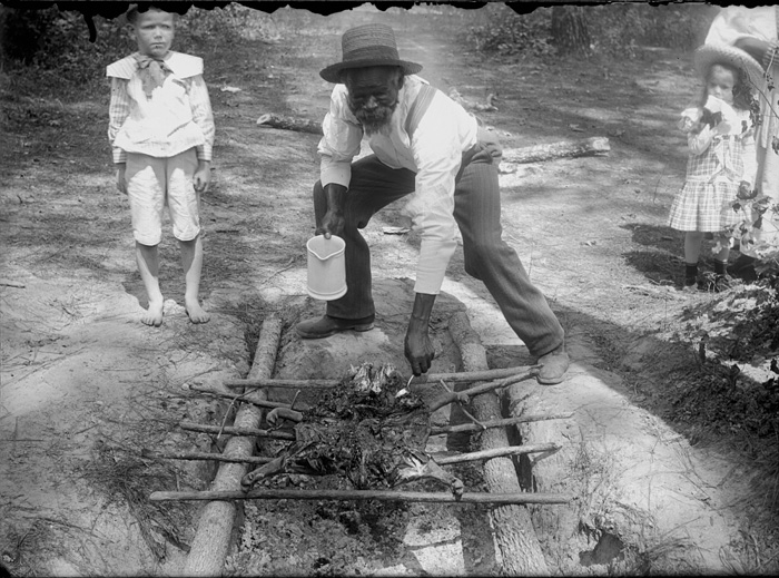 Unidentified Man Cooking Barbecue over Pit, Maryland.
