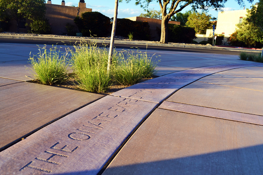 Pigmented concrete bands with lettering create a low maintenance and informative detail in the landscape
