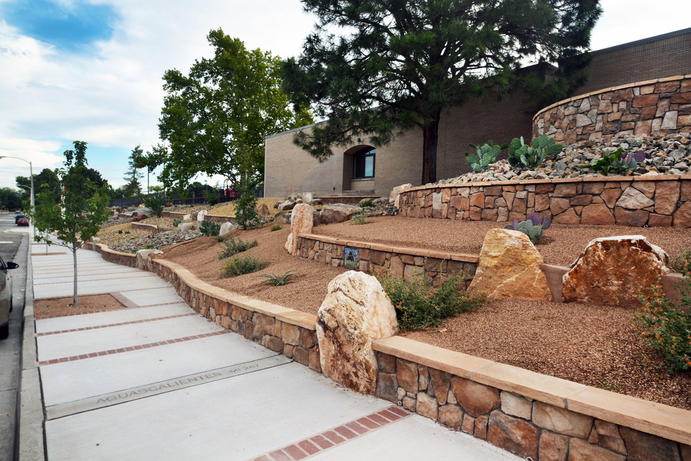 Steep hillside at Longfellow Elementary transformed with handsome stone work