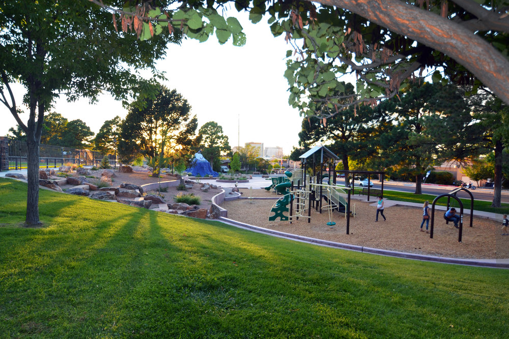 Green space surrounds new children's play area at Martineztown Park, Albuquerque NM