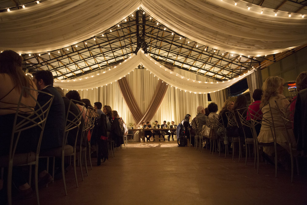 📷: Molly Buckley Photography Rentals: Marquee Event Rentals Lighting: Bright Event Productions Draping, Furniture, Barnwood Tables, and Bars: Quest Events