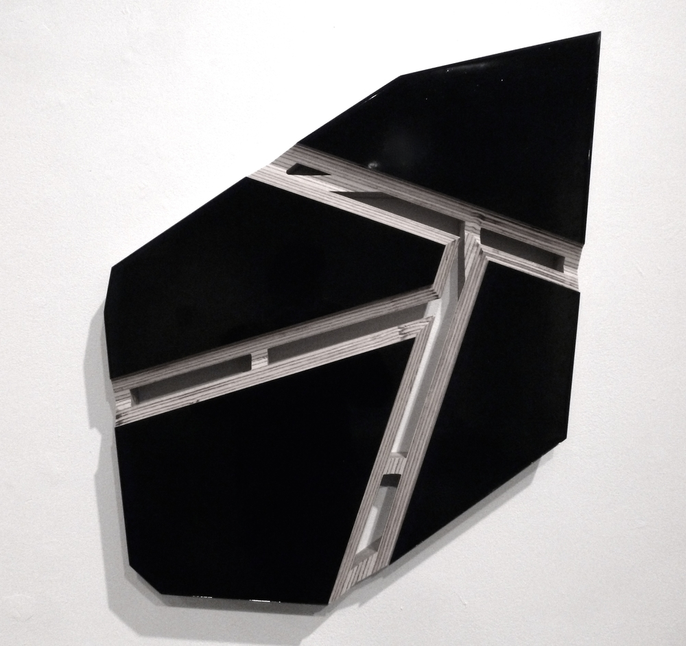 "Black Stone , 2012, pigmented epoxy on routered plywood, 31"" x 20"" x 2"""