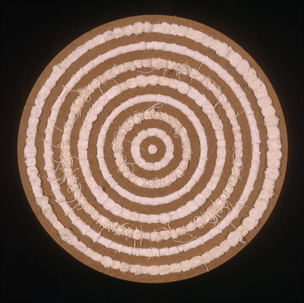 "Rug , 2004, CNC milled MDF rings, rolled canvas, 30"" x 30"""