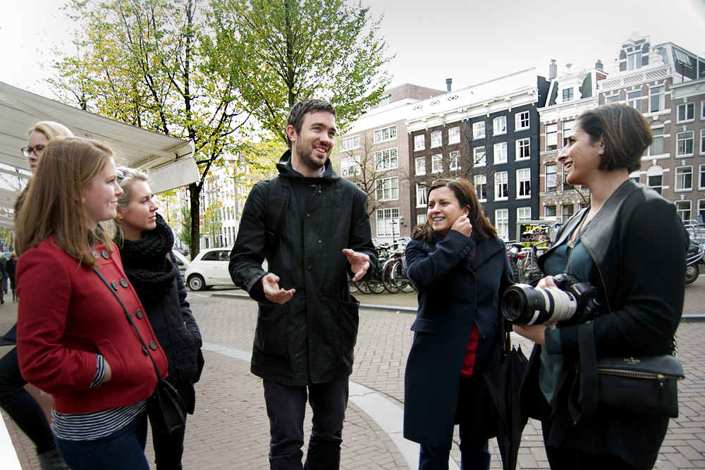 Docent, Tim, leading a private tour in Amsterdam. Flytographer, Traci White captured memories as they strolled.