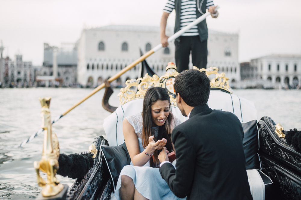 emotional surprise proposal on a gondola in venice