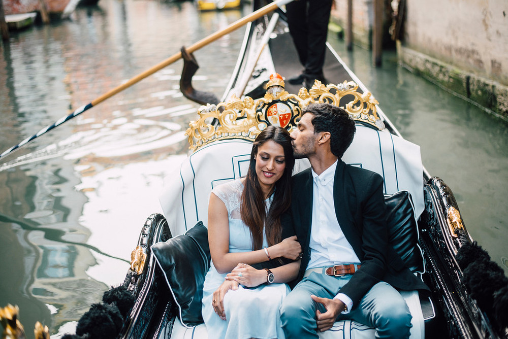 couple on romantic gondola in Venice