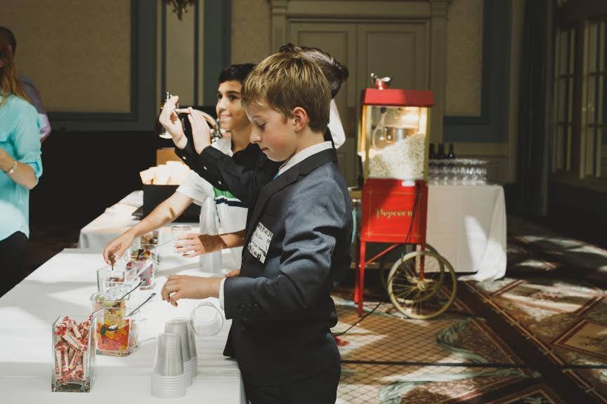 "We served prosecco, popcorn, and had some Flytographer kids run the ""Candy Bar."""