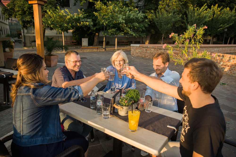 Flytographer Peter in Budapest (on far right) raising a glass with his customers after the shoot.