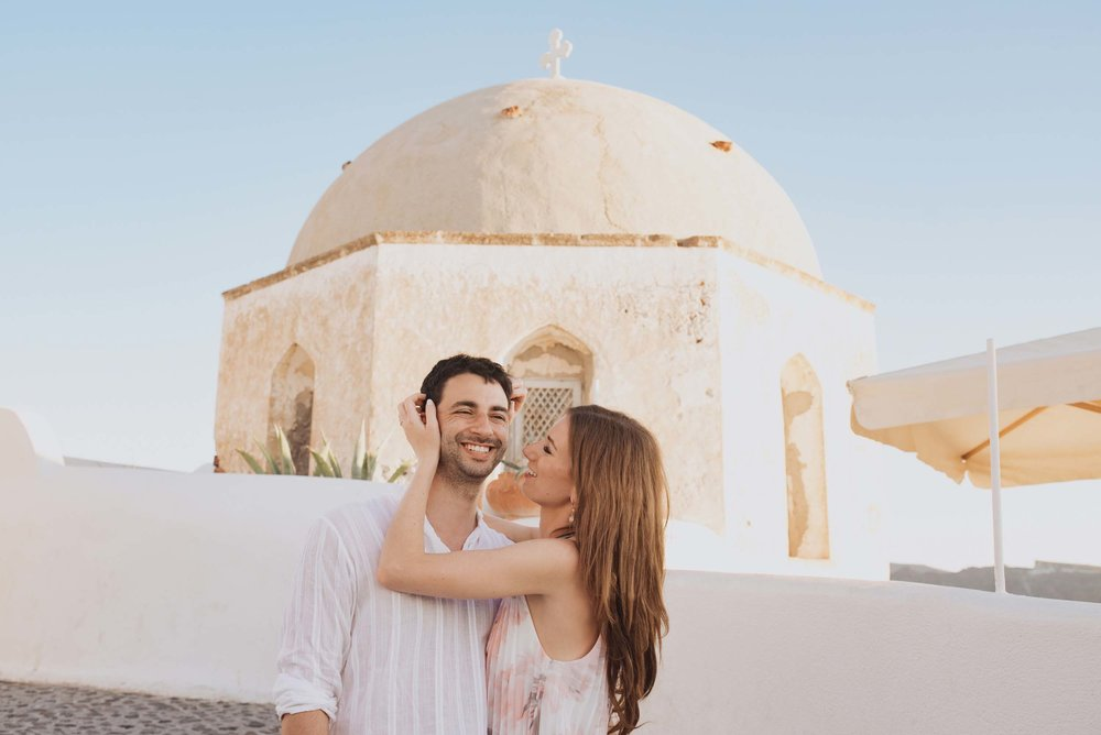 Click to read about gorgeous Santorini as a honeymoon destination on the Flytographer blog! | Travel + Vacation Photographer | Family Vacations | Engagement Proposals | Honeymoons | Anniversary Gifts | Bachelorette Ideas | Solo Traveller Tips |  Flytographer captures your travel memories - everything from surprise proposals, honeymoons, family vacations, and more. So often you are missing out of your own photos! Flytographer solves that problem for you. Our photographers also act as informal tour guides and provide fun local tips to our customers, showing them an area of a city they may not have explored without Flytographer. Book your photographer at 1.888.211.7178 or visit our website at www.flytographer.com/book