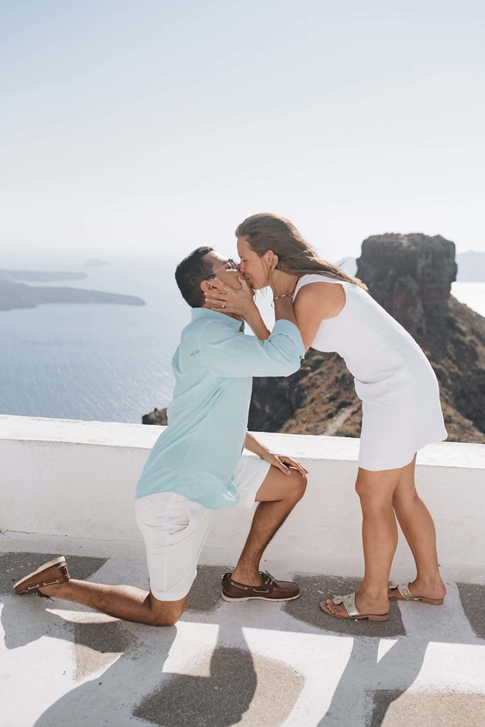 Click to see these dreamy Santorini proposal photos on the Flytographer blog! | Travel + Vacation Photographer | Family Vacations | Engagement Proposals | Honeymoons | Anniversary Gifts | Bachelorette Ideas | Solo Traveller Tips |  Flytographer captures your travel memories - everything from surprise proposals, honeymoons, family vacations, and more. So often you are missing out of your own photos! Flytographer solves that problem for you. Our photographers also act as informal tour guides and provide fun local tips to our customers, showing them an area of a city they may not have explored without Flytographer. Book your photographer at 1.888.211.7178 or visit our website at www.flytographer.com/book
