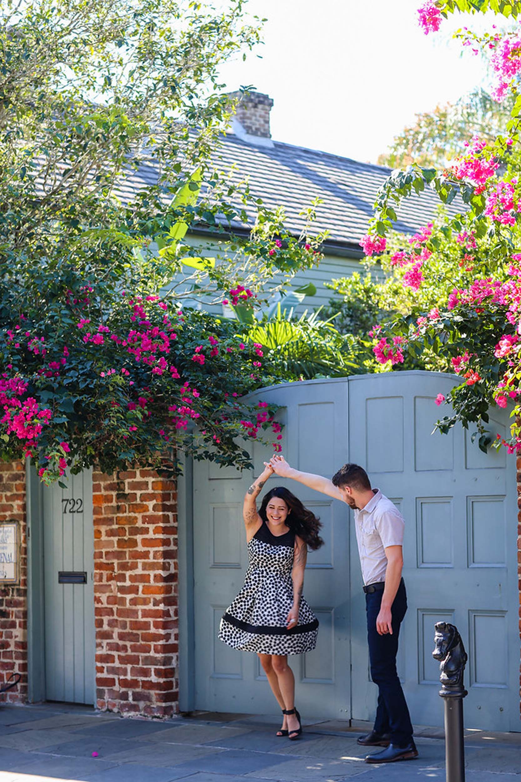 Couple dancing together in alleyway on a couples trip to New Orleans, USA