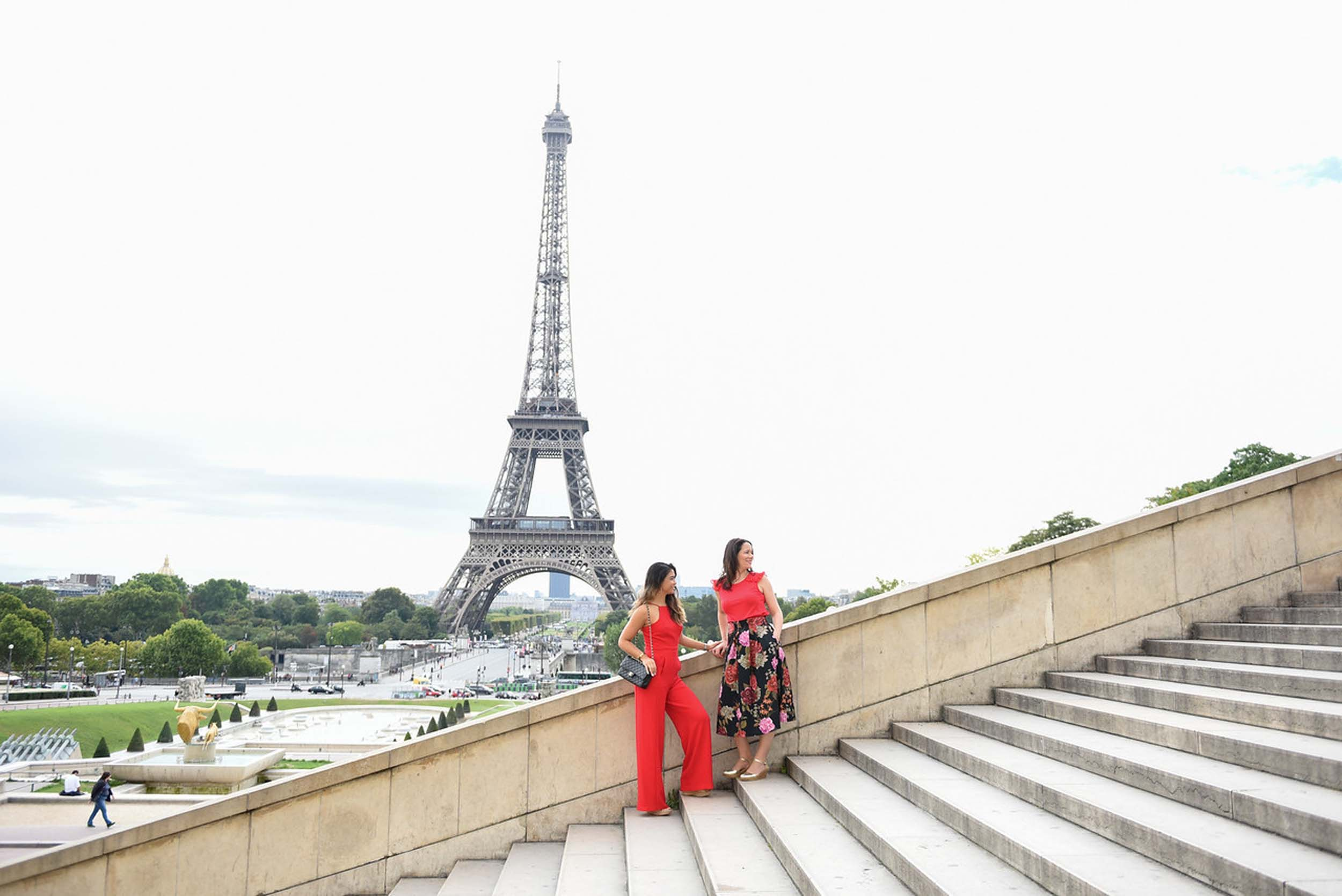 Two women standing on Trocadero steps together with the Eiffel Tower in the background in Paris, France