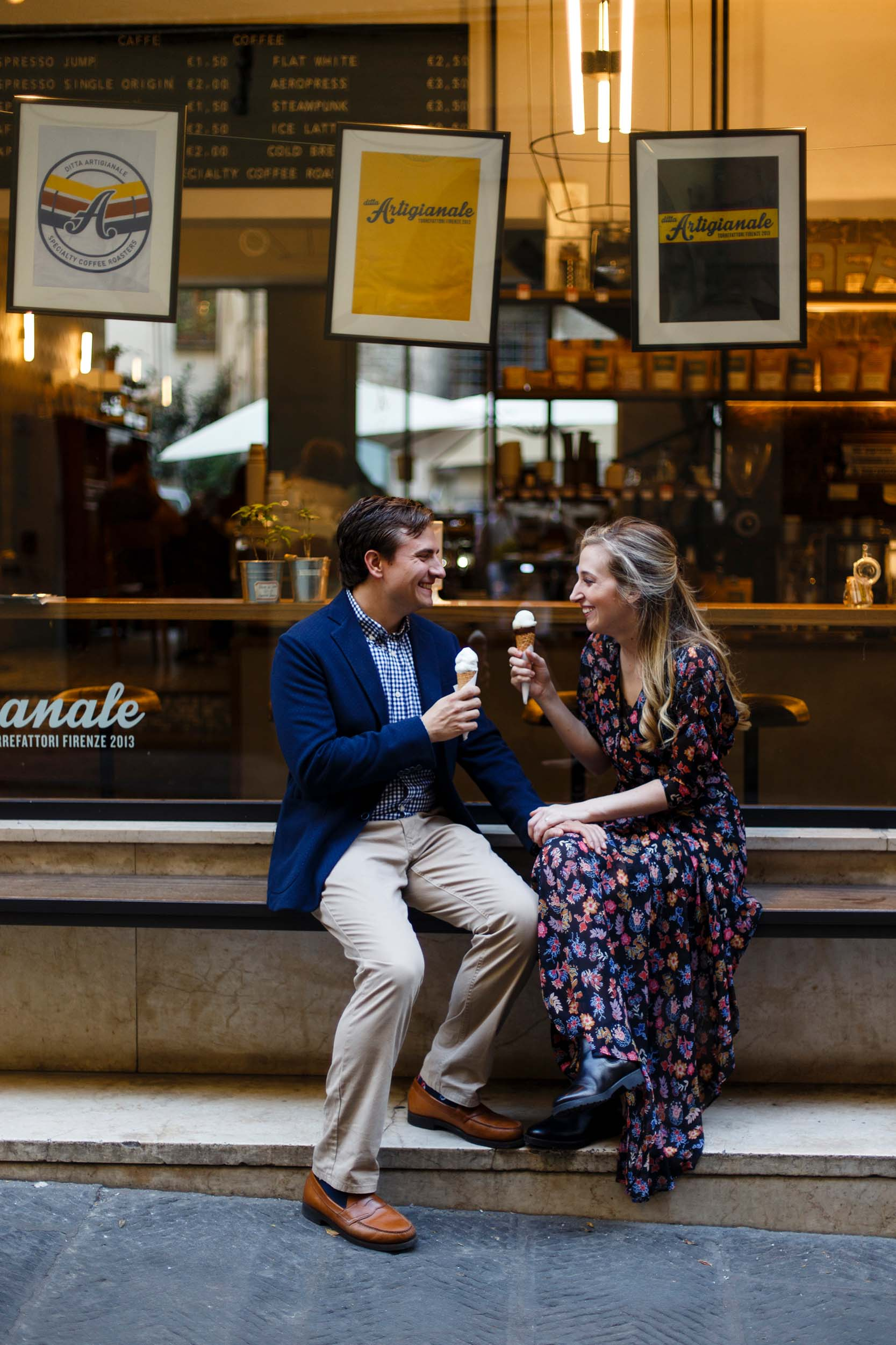 Couple sitting together in front of Ditta Artigianale gelato shop on couples trip in Florence, Italy
