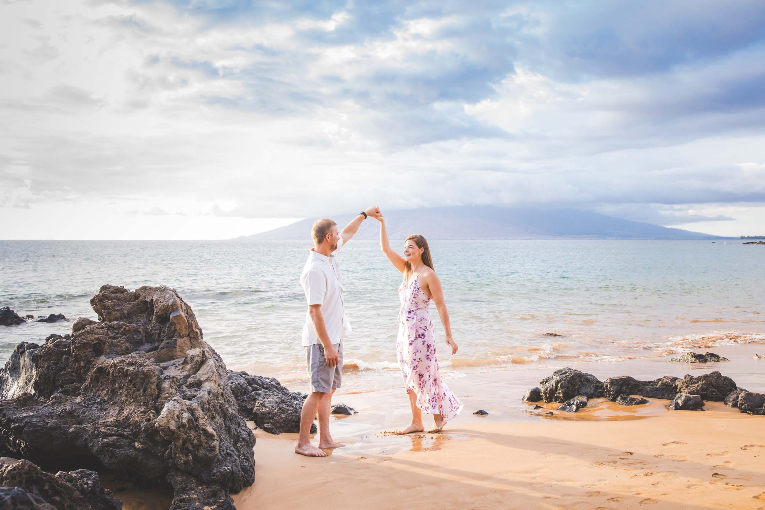 Couple dancing on the beach together in Maui, USA