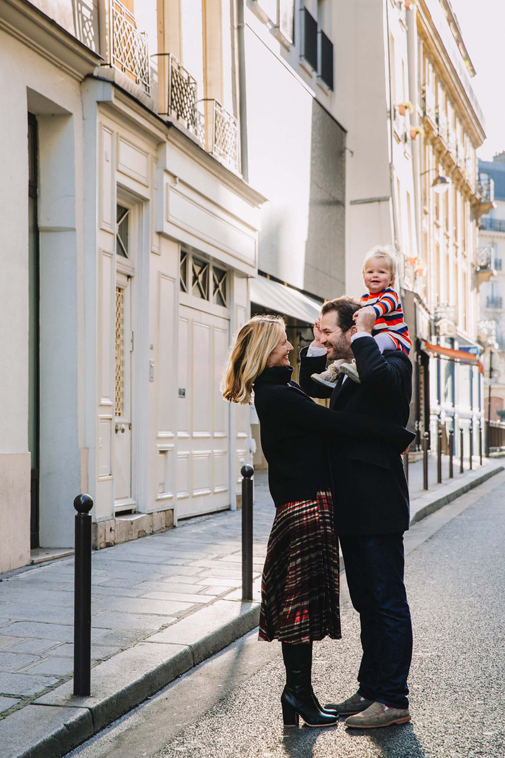 Father and mother with infant daughter in the streets of Paris, France