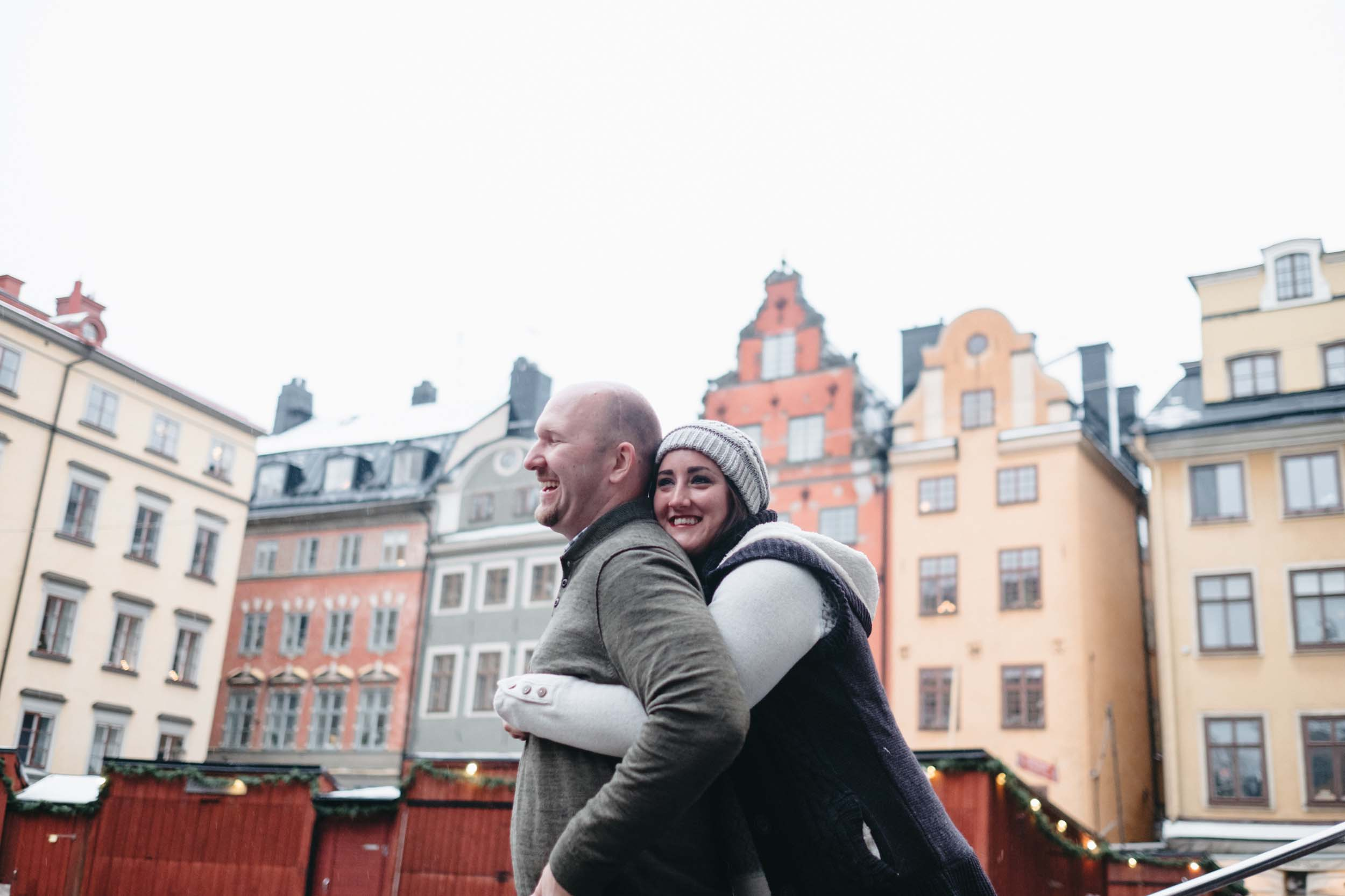 Woman hugging her partner and they are both smiling in Stockholm, Sweden
