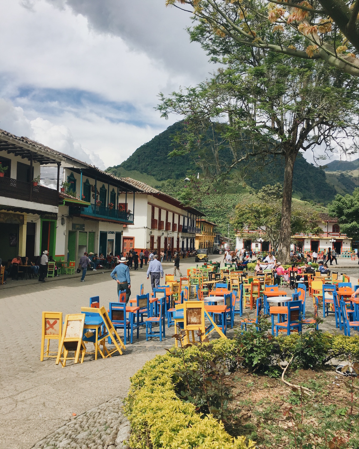 Colourful tables and chairs in the main square of Jardín.