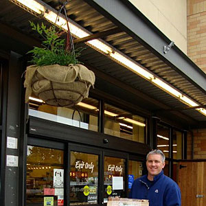 Roy delivering firewood to New Seasons Market