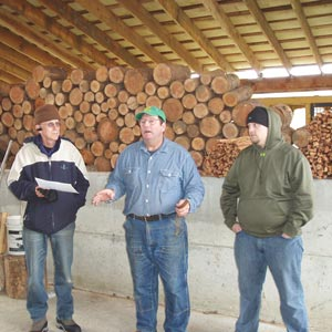 Terry (center) and son Mike (right) produce premium firewood for OWC.
