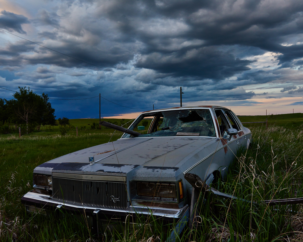 This old Buick was sitting in an abandoned farm in the Neutral Hills north of Consort. It definitely had a creepy feel to the place.. Something out of a Stephen King novel!