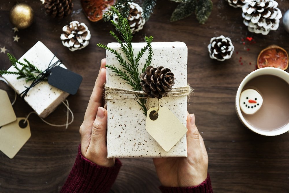 Use uncoated paper and string, even newspaper or fabric this holiday season for beautifully wrapped gifts.