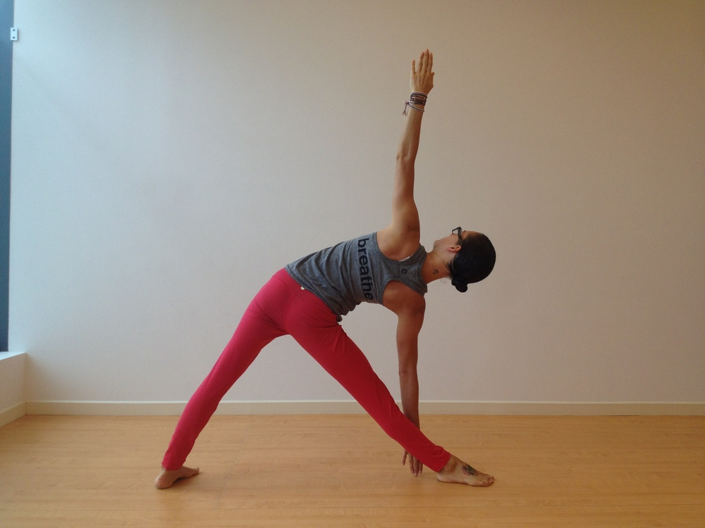 Erin Nichole totally rocking Extended Triangle Pose  (UTTHITA TRIKONASANA)