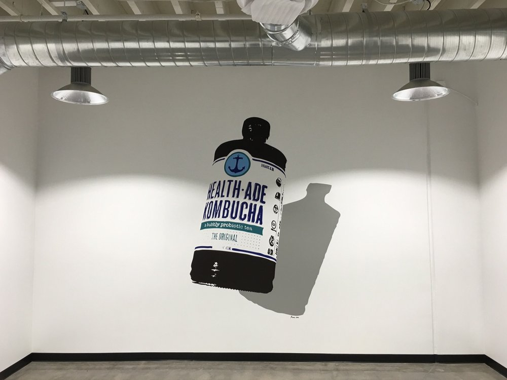 We created a Pop-Art wall art installation in a conference room based on the iconic Health-Ade Kombucha bottle.