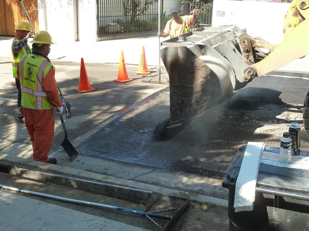 Pour asphalt into the hump area