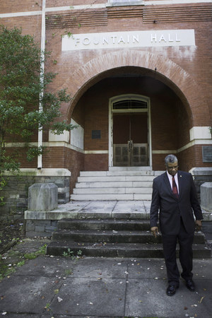 President Stanley Pritchett stands in front of the now boarded-up Fountain Hall, one of the oldest standing buildings on the Morris Brown Campus. Jarrett Christian for BuzzFeed News