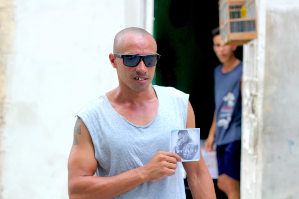 German, a resident of Havana, holding a bootleg copy of Chris Brown's most recent album, Royalty.   Photo courtesy Donovan X. Ramsey