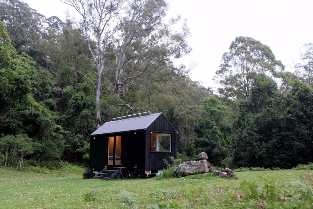 UNYOKED CABIN, KANGAROO VALLEY - Architectural design + buildEmbodying Unyoked's vision for minimum footprint, maximum chill, this tiny cabin uses sustainable materials and off-grid technology to create an authentic connection with the surrounding natural environment.read more >