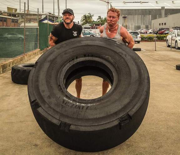 Crossfitters flipping tire as a team.jpg