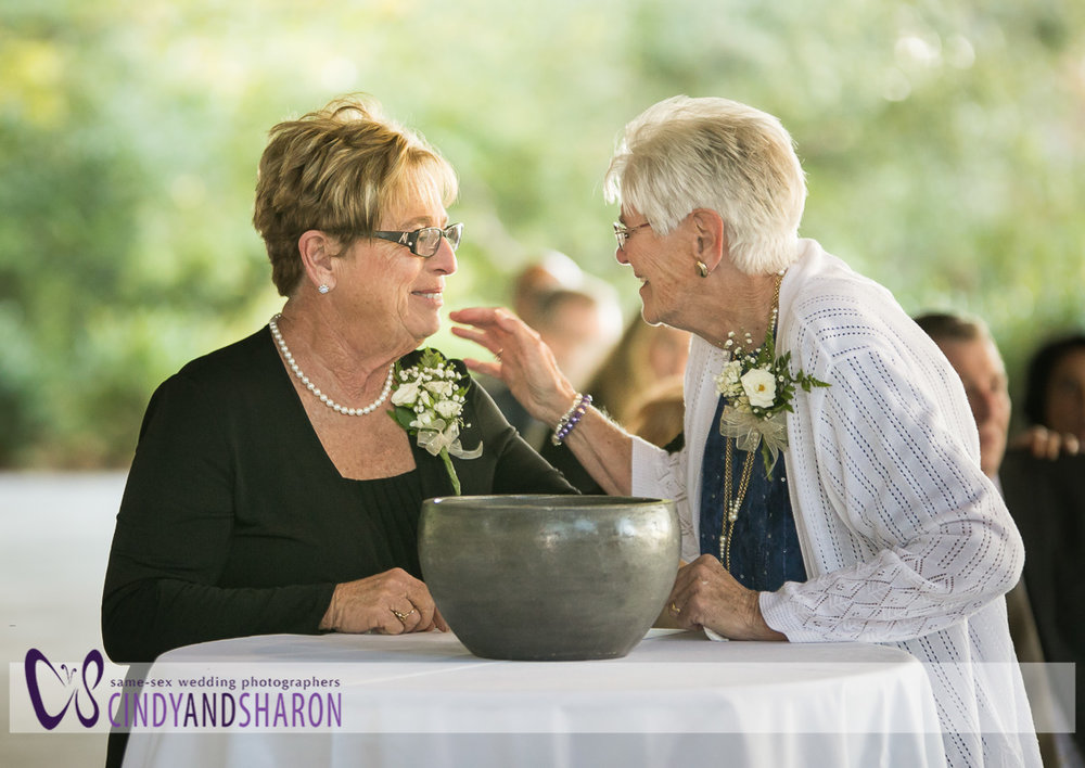 The mothers of the grooms share a moment.