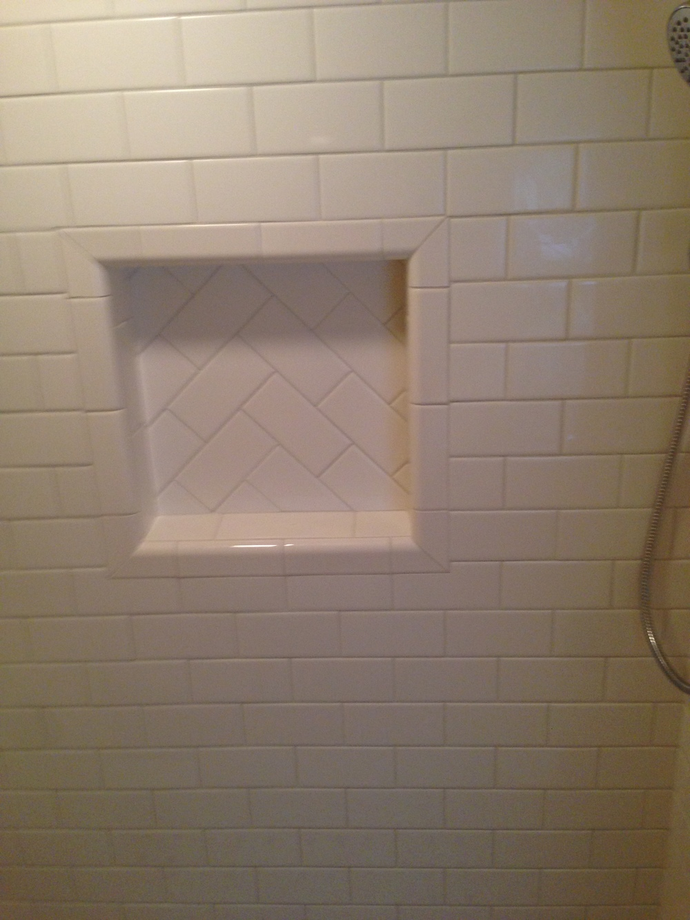 A waterproof tiled soap niche