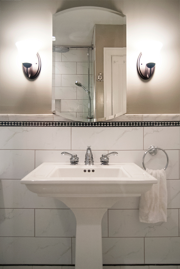I have always been a fan of Kohler!  This is a kohler pedestal sink, faucet and mirror.