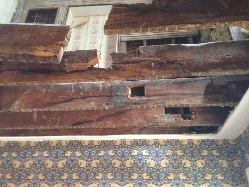 Below view of joists, after ceiling was removed in dining room.
