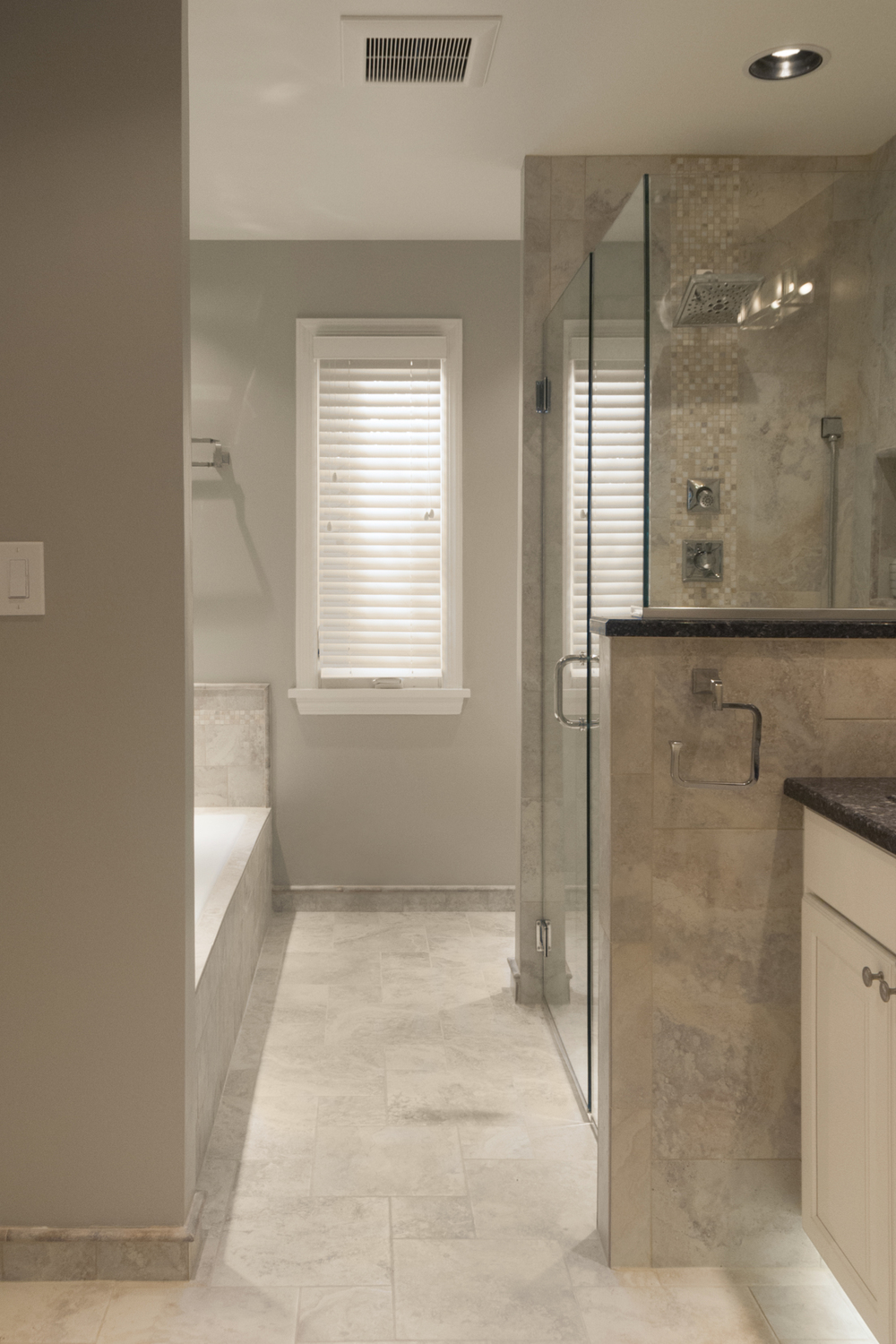 Natural stone bathroom with open shower