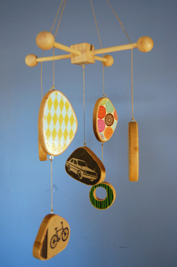 Really like the idea of a wooden mobile. And this one is exceptionally well done. (via Colorful Wood Baby Mobile made with Echino Fabric by outofthebox)