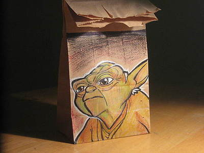 This dad draws a picture on a lunch bag for his kid each day.  Super cool.    Lunch Bag Art