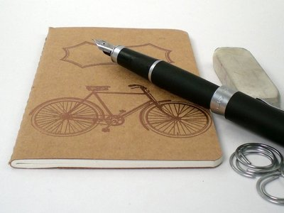 pedalr.com is an online marketplace for bikes and bike related items.  i like this little journal that is handstamped - since i'm trying to move into a smaller notebooks phase.    Pocket Journal — lined handstamped | Bike Cozy | Miscellaneous | Pedalr.com