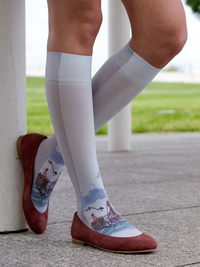 Just found these socks again when I was looking for a link for a friend to find socks for his wedding.  I absolutely adore these and if they weren't $45 and had international shipping, I would certainly own them.  They look embroidered, but are actually printed, so the design stretches appropriately with the fabric.  Fantastic idea, fantastic subject matter = love it! Fishing Boat Knee-High - kvast