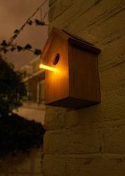 I like this idea, but couldn't justify the 70 pounds to buy it from oooms.  The solar-powered LED perch charges during the day, and then at night attracts bugs/food right to the bird's door.  Also it just looks neat. OOOMS | dutch design