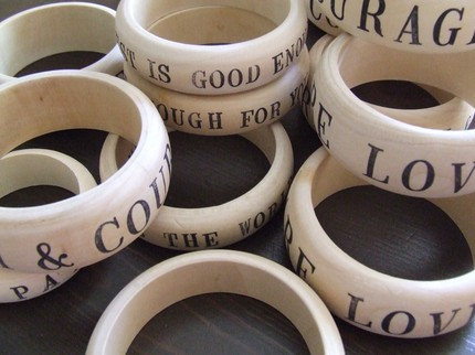 Custom text on a wooden bangle = pretty wearable inspiration.  Letters are stamped on bangles of two sizes for $23.  Great idea.    Etsy :: palomasnest :: CUSTOM words on your wrist -wooden bangle bracelet with stamped text